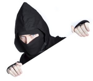caucasian man disguised as a ninja isolated on white