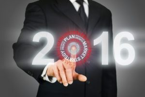Businessman clicking 2016 business target
