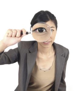 woman magnifying responsive web design