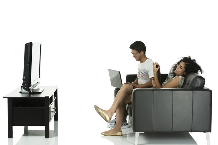 couple on couch watching TV branding